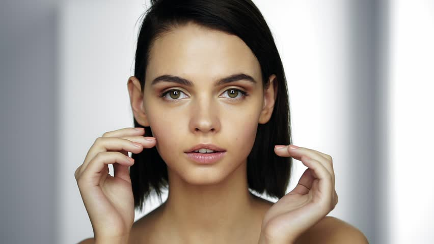 Charming young woman with perfect skin. Youth and Skin Care Concept. Close up