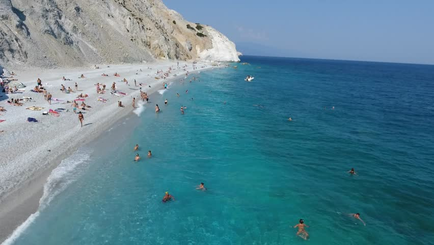 SKIATHOS, GREECE, SEPTEMBER 2016: Aerial footage of the famous Lalaria beach on the Skiathos island in the Aegean sea in Greece.