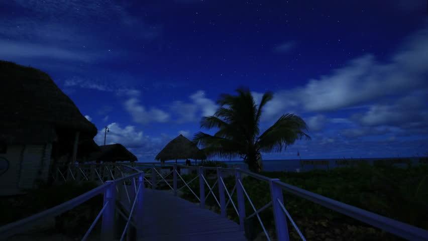 Tropical Beach Resort Lit By Moonlight At Night
