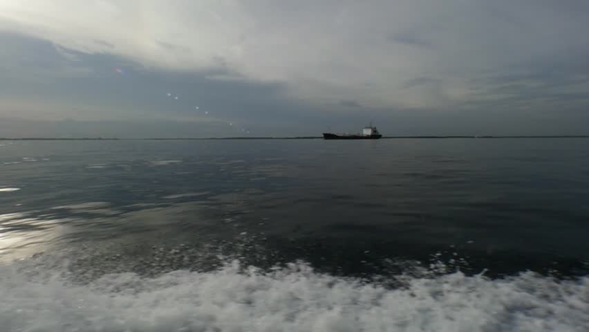 Waves from a motor boat against a background of the sea horizon in Indonesia. Cruise on the blue water. Extreme sport. Speed Regatta. | Shutterstock HD Video #25043462