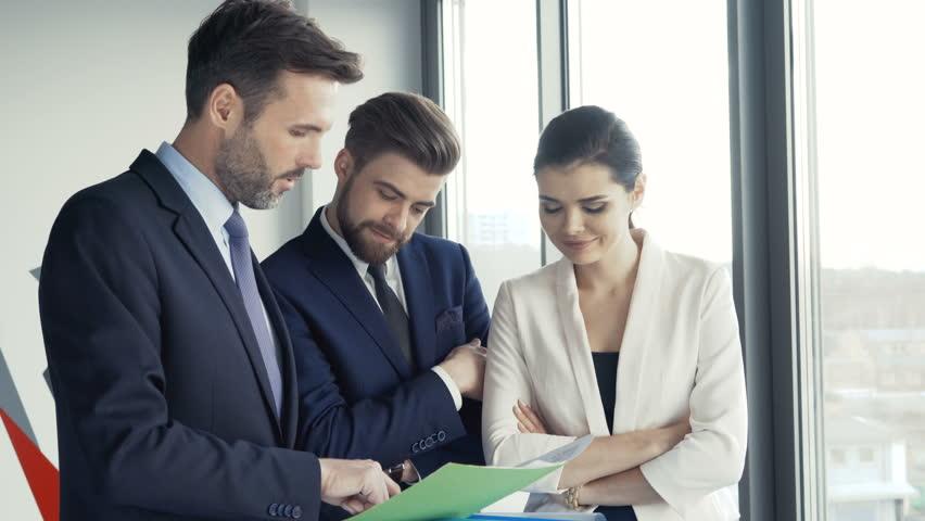 Business people talking at modern office, making a deal | Shutterstock HD Video #25050326