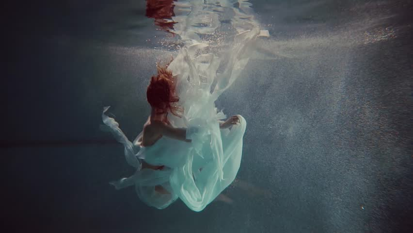 Young woman swimming under the water | Shutterstock HD Video #25053293