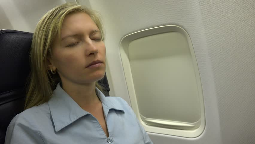 Asleep Business Woman Traveler On Airplane, Tired Lady Sleep Inside Plane Jet Cabin | Shutterstock HD Video #25077563