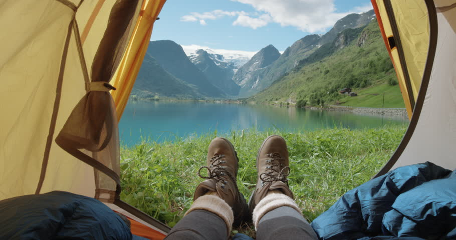 Camping woman lying in tent Close up of Girl feet wearing hiking boots relaxing on vacation POV   Shutterstock HD Video #25126919