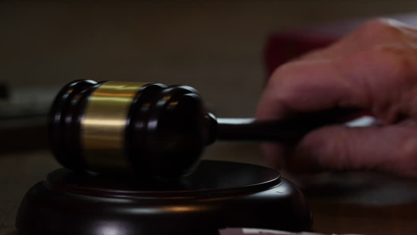 Judge hand close up and gavel hammer hit court adjourned