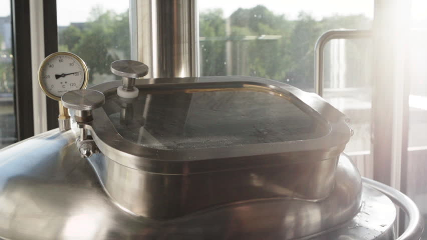 The worker opens the lid of the apparatus for the production of beer. Steam is coming from the apparatus. Beer production. Rapid video. | Shutterstock HD Video #25155353