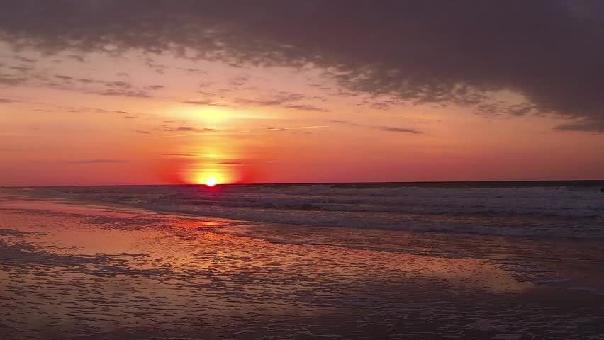 The sun rises over the Atlantic Ocean at Pawleys Island, South Carolina - HD stock footage clip