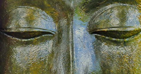 Close up eyes of ancient Buddha Statue face in religious Buddhist complex in Ubud, Bali, Indonesia