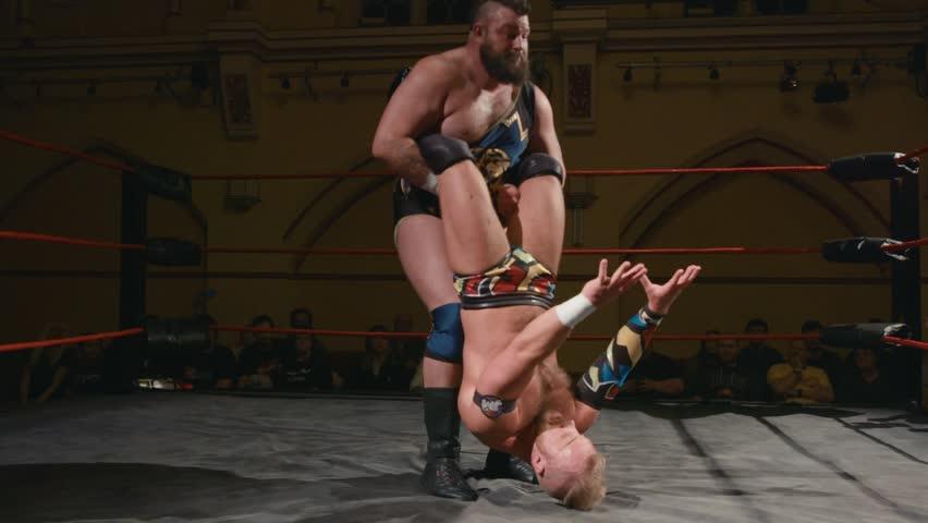 Pro Wrestling Match: Wrestler Thrown into Corner (slow motion)