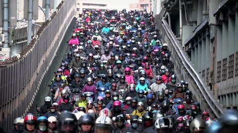 Traffic on the bridge through Taipei.city Crowed of people are riding scooters