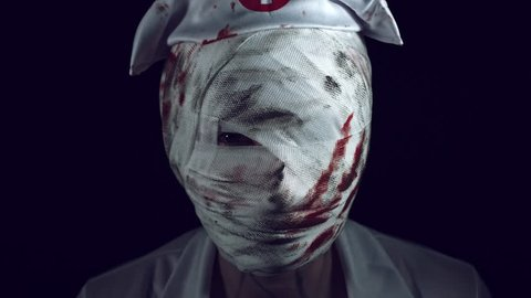 Nurse Zombie Face Appearing from Darkness