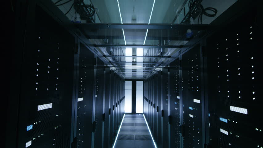 Descending Camera Shot of a Working Data Center Full of Server Racks. Shot on RED EPIC-W 8K Helium Cinema Camera. | Shutterstock HD Video #25243073