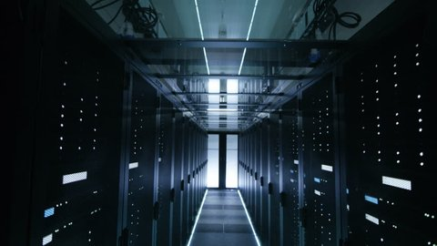 Descending Camera Shot of a Working Data Center Full of Server Racks. Shot on RED EPIC-W 8K Helium Cinema Camera.