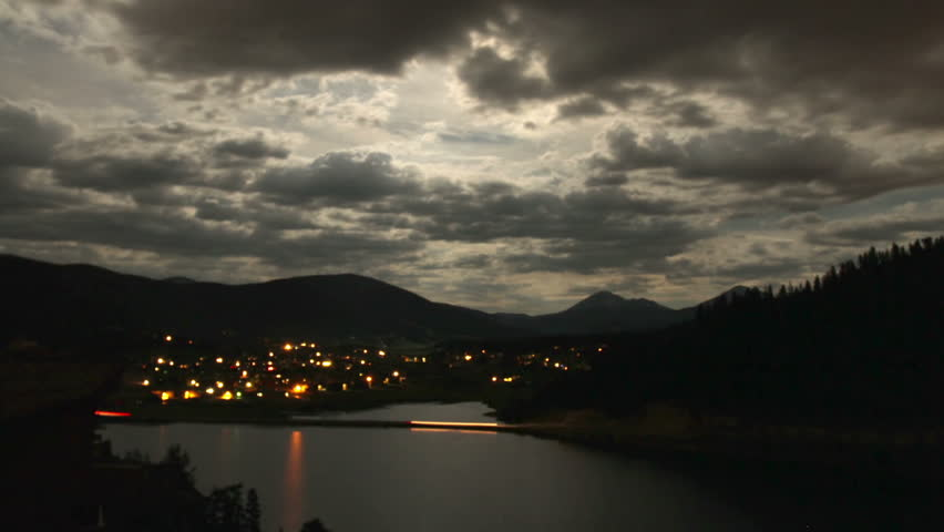 Night falls on a small mountain town in the Rocky Mountains of Colorado.  HD