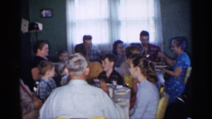 MINNESOTA 1958: many peoples are sited near a dining table and chat each other very happily and eat some snacks | Shutterstock HD Video #25264331