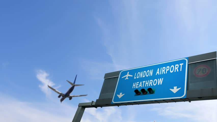 plane flying over heathrow airport signboard