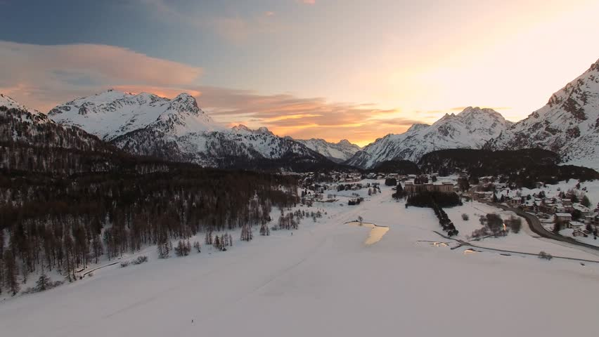 Aerial view of sunset in Alps mountains, near Saint Moritz in Winter, Switzerland from above
