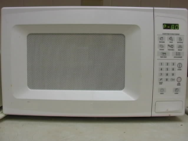 Microwave cooking a delicious meal.