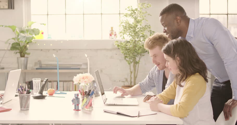 Track across table in casual sunny startup office with young happy adults. Raw version available on request | Shutterstock HD Video #25328252