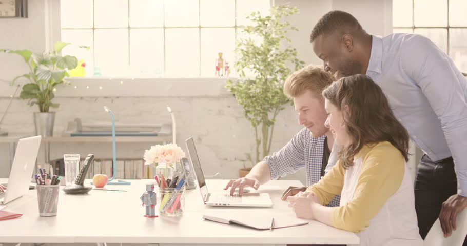 Track across table in casual sunny startup office with young happy adults. Raw version available on request | Shutterstock HD Video #25328273