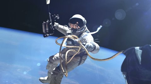 Astronaut in outer space against the Earth background. Elements of this image furnished by NASA.