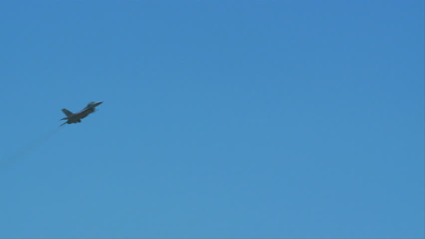 QUONSET, RHODE ISLAND - JUNE 2012: Air force F-16 Falcon flying by while rolling at the Rhode Island National Guard Open House and Air Show in June 2012.