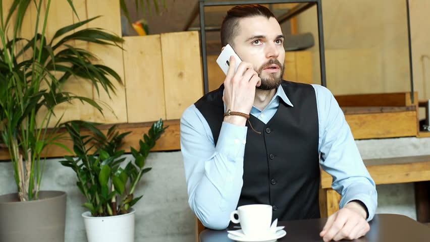 Handsome businessman having an argument while talking on cellphone, steadycam shot  | Shutterstock HD Video #25349603