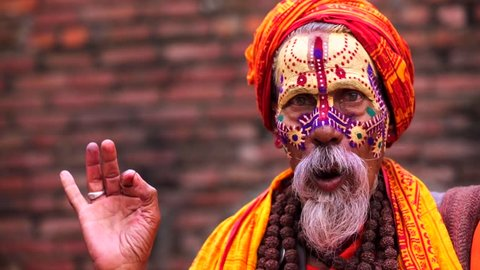 Portrait of sadhu (religious ascetic or holy person) in the Pashupatinath temple complex that is on UNESCO World Heritage Sites's list Since 1979. Kathmandu, Nepal.