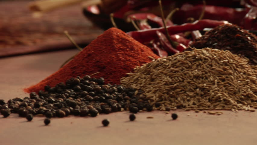 mexican chef selecting spices for a blend