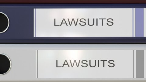 Vertical stack of multicolor office binders with Law suits tags