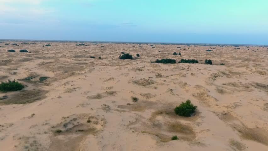 Flying backwards over picturesque sand dunes in desert