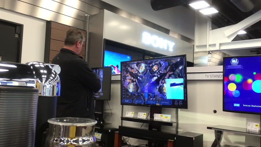 samsung tv best buy. burnaby, bc, canada - january 05, 2017 : motion of people looking new samsung tv best buy