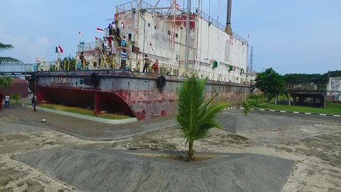 PLTD Apung 1 is an electric generator ship in Banda Aceh, Indonesia. The 2,600 ton vessel had been in the sea and was flung 3 kilometres inland by the 2004 Indian Ocean earthquake and tsunami.