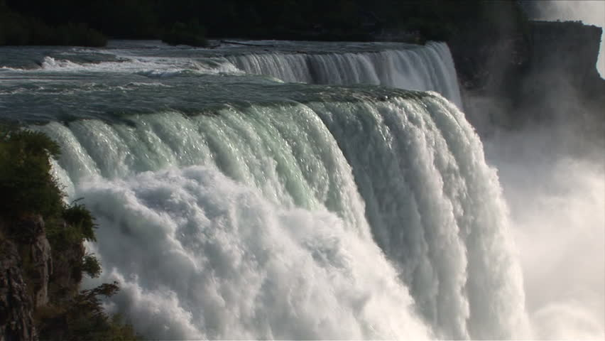 The powerful falls of Niagara majestically flow off and amaze. Truly a natural wonder of the planet Earth