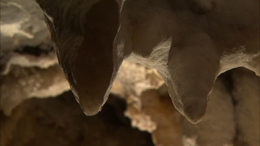 Dramatic lighting on broken stalactites in cave