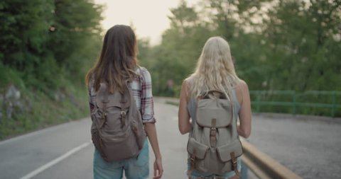 Best friends hiking together Two young woman sharing travel adventure Girls enjoying nature on summer vacation