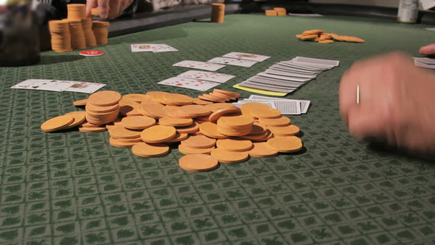 Poker chips on the table while dealer picks up the cards | Shutterstock HD Video #2549183