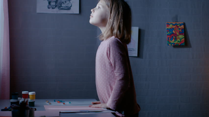 Curious Little Girl in Her Bedroom Runs Toward Window and Looks Out on Tiptoe. Shot on RED EPIC-W 8K Helium Cinema Camera.