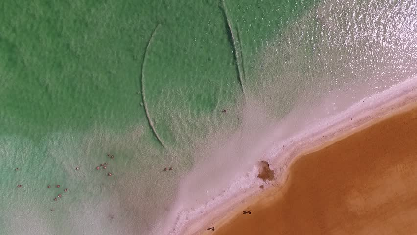 Dead sea - 05, March 2016: People swim in the water at the Dead Sea, Israel. Drone footage 1080p   Shutterstock HD Video #25545503