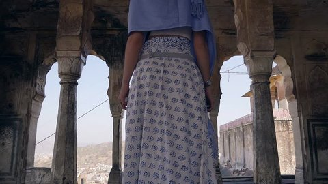Glide back the release of girls in saris from the ancient temple in the mountains of India.