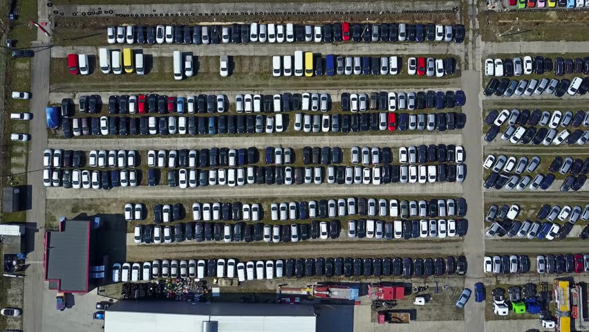 Aerial shot of new cars and trucks parking, top view. 4K video