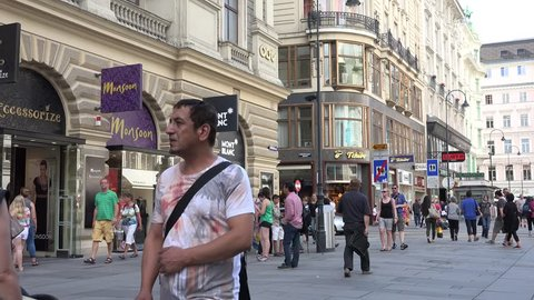 VIENNA - AUSTRIA, JULY 16, 2014, 4K Crowded shopping street in old town, people enjoy commercial district