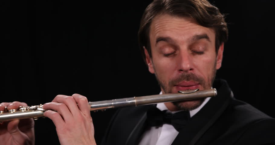 Closeup Shot Portrait of Flutist Musician Play Flute Instrument Orchestral Music