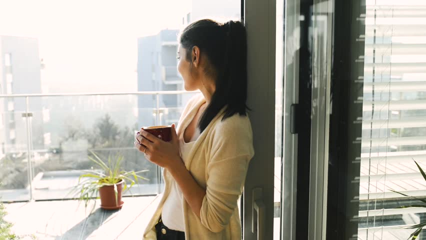 Woman relaxing on balcony holding cup , drinking coffee or tea #25607273