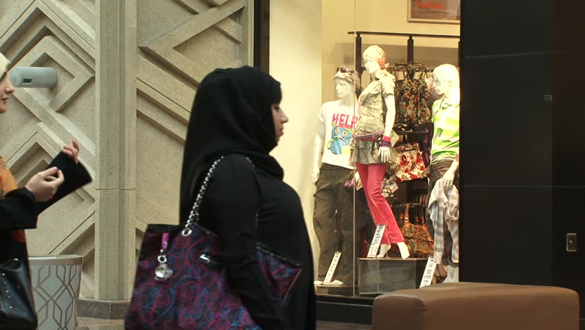 DUBAI, UAE - CIRCA 2008: View of two Emirati women shopping in the souq at Dubai Festival City Mall.