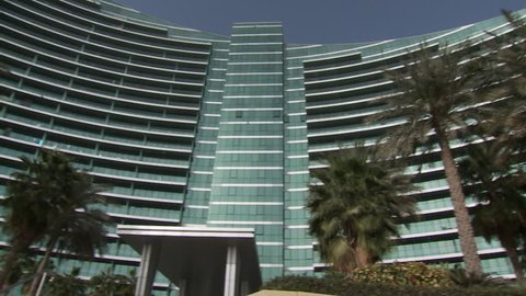 DUBAI, UAE - CIRCA 2013: Low-angle pan-right across the fa\x8Dade of Marsa Plaza in Dubai Festival City's Marsa al-Khor district. The building is an example of luxurious Creek side real-estate.
