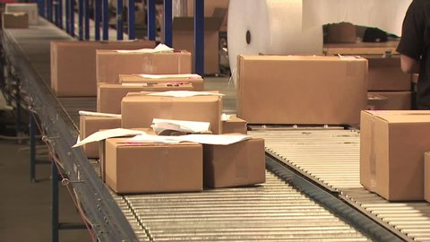 Several Boxes Moving On A Conveyer Belt