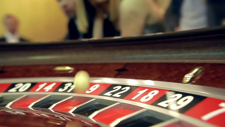 image with a casino roulette wheel with the ball on number