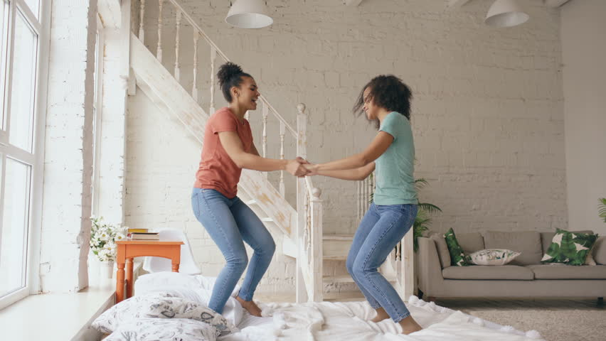 Mixed race young beautiful girls dancing on a bed together having fun  leisure in bedroom at. Black Girl Dancing In Bedroom Stock Footage Video 4432370