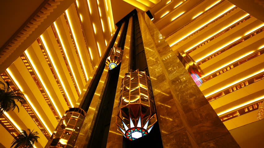 Wide angle view of the interior elevators going up and down inside a luxury hotel in Doha, Qatar